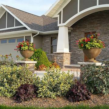 front walkway landscaping wiht potted planter pillars and beautfiful plants